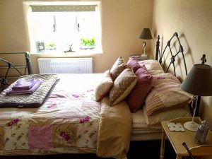 A Week at 28 Stone Cottage in Thorington, Suffolk: The master bedroom
